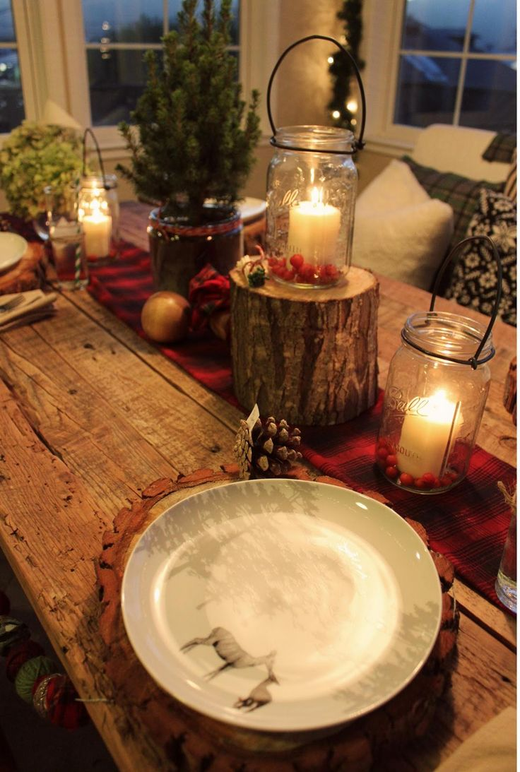 Rustic cabin Christmas. Love the table and the warm glow from the candles.