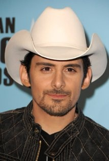Brad Paisley received a Care More Creations Wire Wrapped Pendant backstage at the Official Gift Lounge of the 46th Annual CMA Awards. www.caremorecreations.com