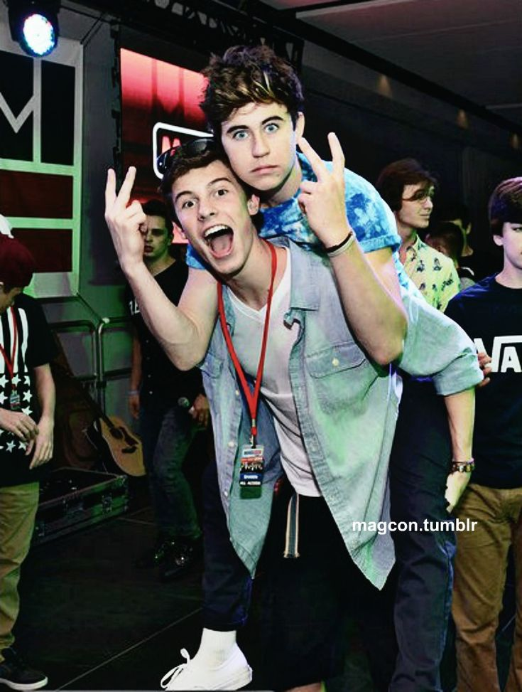 He's doing the peace signs for shawn!!  (if you don't know what i meant by this you are not a true MAGCON fan!!)