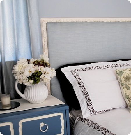 Lovely Blue fabric covered headboard with decorative frame