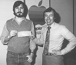 Steve Jobs and Mike Markkula with a check for Apple financing  in 1977.