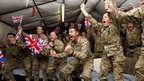 Military colleagues of Heather Stanning in Afghanistan celebrate her victory