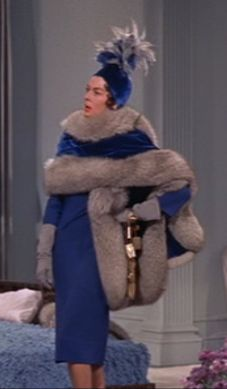 "Auntie Mame with Rosalind Russell.  When she finally takes her wrap off and turns around at the end of the scene,...the back of this dress is ""To Die For"""