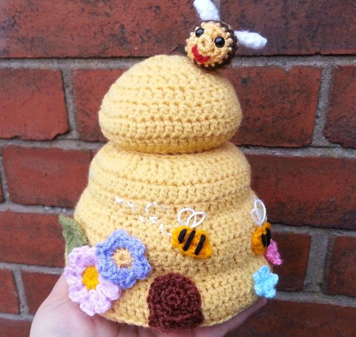 Materials   Approx 80g of custard colour DK (I used crepe) for the main beehive and small amounts of colours for the flowers, bees and d...