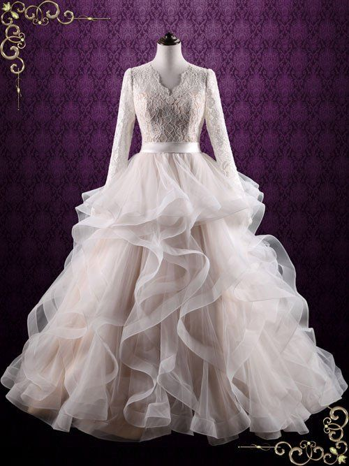Beautiful ruffled ball gown wedding dress with modest lace long sleeves. Photoed in Champagne (champagne lining with ivory lace and tulle), can also be made in another color such as all ivory or white
