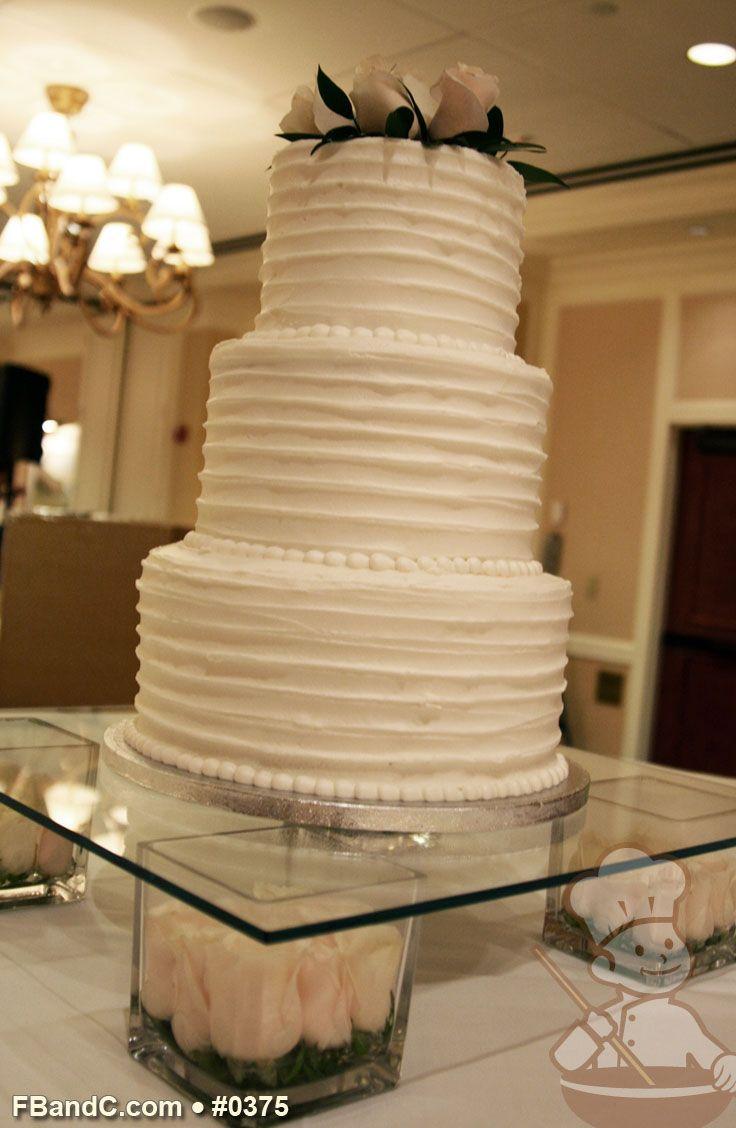 "Design W 0375 | Butter Cream Wedding Cake | 10""+8""+6"" | Serves 75 | horizontal texture buttercream, Fresh Flowers | Standard Price"