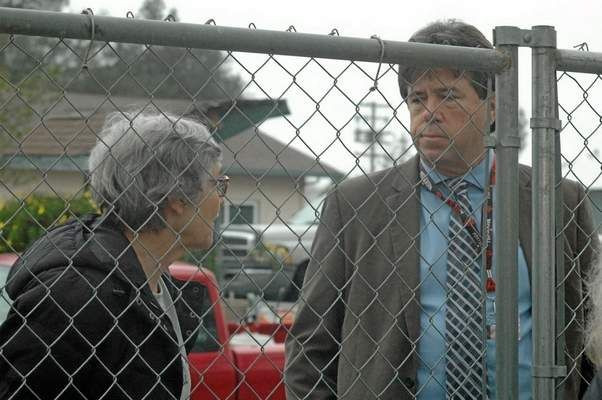 Carol Anderson talks to Oroville City Administrator Randy Murphy in this February file photo outside a fence set up for PG&E crews to begin cutting down a stand of aged trees in front of the Oroville Cemetery. Murphy was fired by the City Council Tuesday night. (Barbara Arrigoni — Mercury-Register file photo)