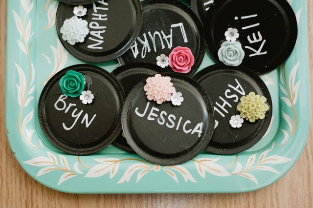 name tags made from jar lids, chalkboard paint, and clay flowers...super simple! Good idea for showers or gatherings, guests can write their names when they arrive.