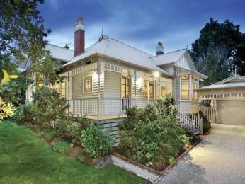 Corrugated iron edwardian house exterior with balustrades & landscaped garden -