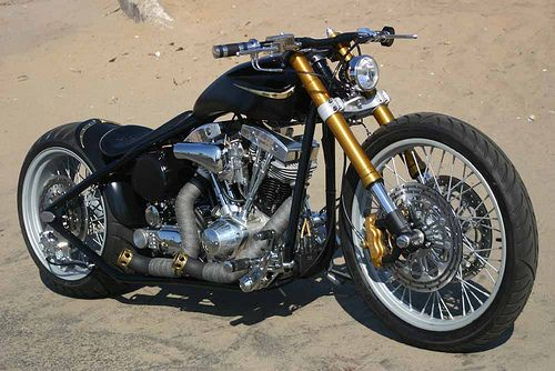 Harley bob, <3 that wide front with the reversed forks and those pipes look crazy