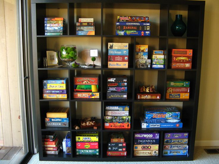 Board Game Storage in a 5x5 IKEA Expedit shelving with some of the dividers removed. Family room