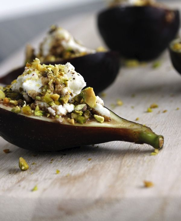 A decadent fall snack: figs stuffed with goat cheese and pistachios.