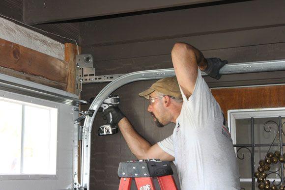 Photo #8: Installing the new Clopay garage door.