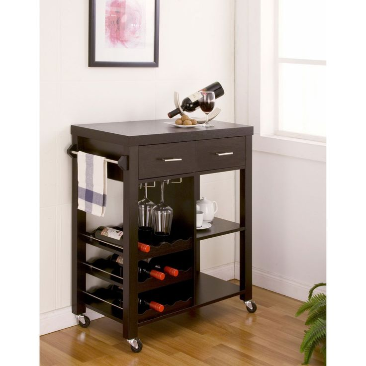 This mobile kitchen bar cart is ideal for adding storage and sophistication to your decor. It offers plenty of additional space, particularly for wine bottles and paraphernalia, and its stylish design is complemented by eye-catching metal pulls.