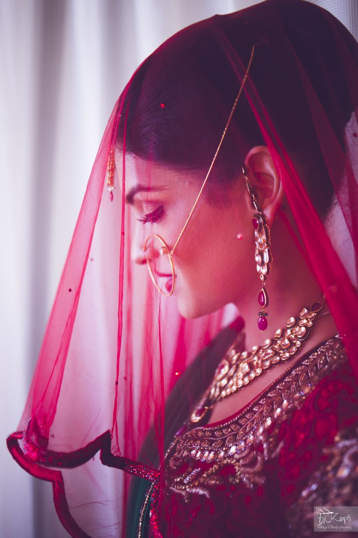 Gorgeous Indian Bride with red veil