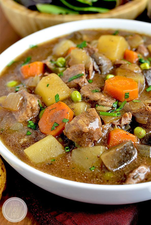 Crock Pot Beef Stew is easy, hearty, and comforting. Toss everything into the crock pot at night then pop into the base and cook the next day! #glutenfree   iowagirleats.com