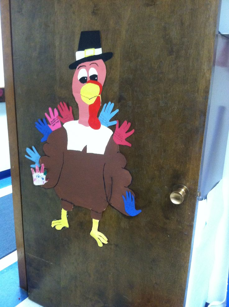 a turkey I painted and then we cut out the kids hands and after writing what they are thankful for we build the turkey's tail feathers