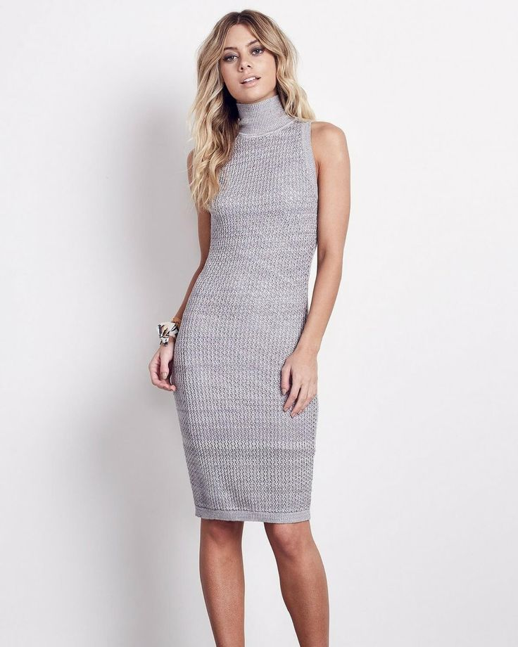 The Ali & Jay dress in grey, is a sleeveless fitted sweater knit dress with high mock neck detail and key hole back.