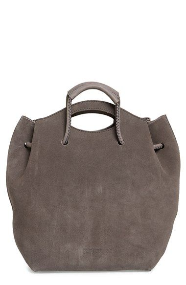 Free shipping and returns on Pedro Garcia Suede Drawstring Bucket Bag at Nordstrom.com. A set of drawstring handles provides a modern twist on a buttery-soft suede bucket bag done in a slightly slouchy silhouette. A second set of cutout handles and a detachable interior pouch—perfect for securing your sunglasses and smartphone, or acting as a fashionable little clutch in a pinch—complete this sophisticated bag.