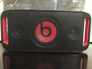 MONSTER BEATS BY DR. DRE BEATBOX PORTABLE SPEAKER IN BLACK AND RED. COMES WITH POWER ADAPTER