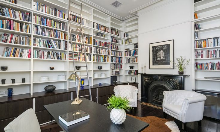 Reading room with walls of built-in bookcases. Modern. North Adelaide. Living. InDaily.