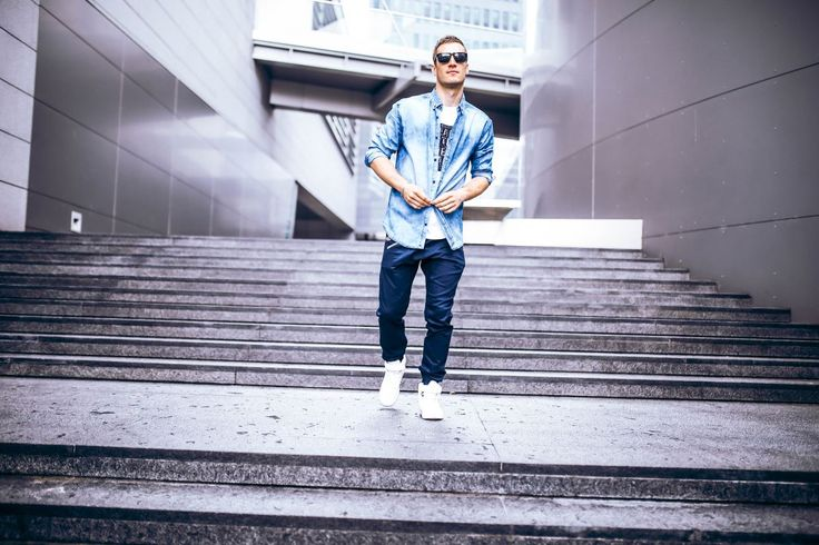 Astonishing styling from Bolf for a unique man. Navy blue joggers are matched with a printed T-shirt and a blue denim shirt. We haven't forgot about accessories! A sunglasses, a bracelet and trendy sneakers boost this look up amazingly.