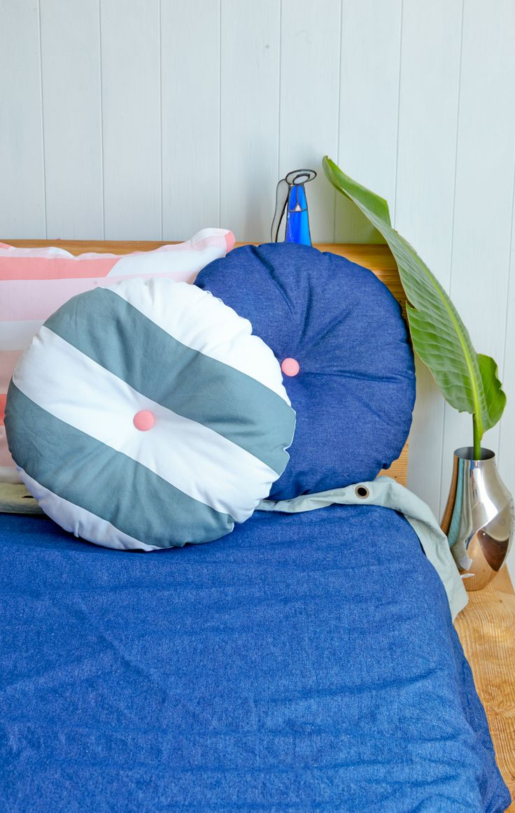 The Roundies! Grey Stripe with Pink Button + Denim with Pink Button on our Dark Denim Quilt Cover. Online at our shop friends | http://onekinddesign.com.au/ #kidsrooms #childrensrooms #homestyle