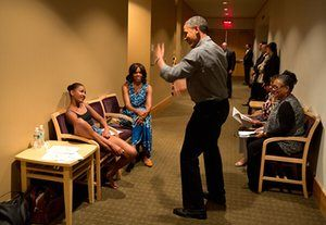 Obama shows off his dance moves as he and Michelle wait backstage during his daughter Sasha's dance recital.