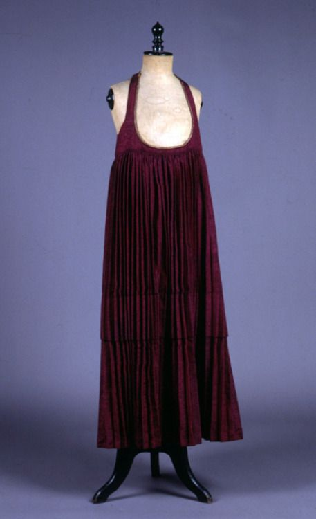 """Foustani"". Pleated dress. H. 1.24 m. Skiathos, Sporades, Greece. Late 19th century. Peloponnesian Folklore Foundation Collection, Nafplion. Donated by Ioanna Papantoniou. 1976.6.106. ""Foustani"". Red silk pleated dress with straps. Off-white cotton..."