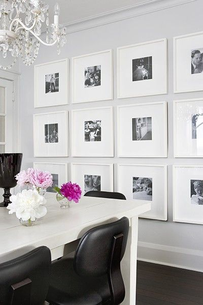 white frames with large mats give a contemporary, sleek feel to this wall gallery