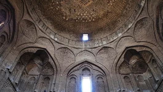 The Grand Mosque: Inside the south dome of Esfahan Jameh mosque.  Initially built in 771 AD, the south dome was erected in 1086-87 during Seljuq period and was commissioned by Nizam Al Mulk, a powerful Seljuq vizier. The roof of the southern dome is decorated with Muqarnas cells and several Kufic Stucco were added during Ilkhanid period in 13th cent AD.  Esfahan, April 2017