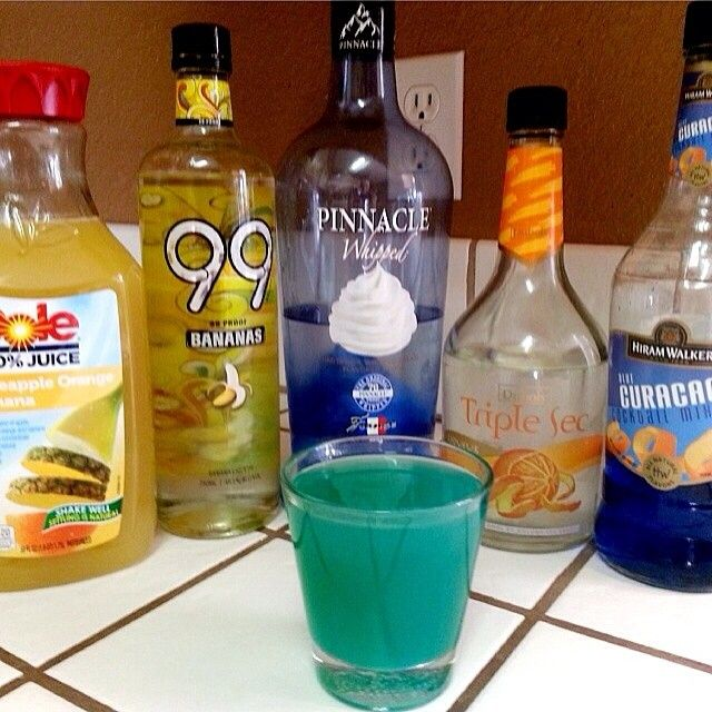 REEF WATER 1 oz. (30ml) Whipped Vodka 1 oz. (30ml) 99 Bananas 1/2 oz. (15ml) Triple Sec 1/2 oz. (15ml) Blue Curacao 2 oz. (60ml) Dole Pineapple Banana Orange Juice #vodka #drinkporn #foodporn...