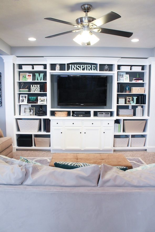 I like the built-in look of this one, AWA the open back to add color. The shelves, baskets, & drawers all fit my taste, too.