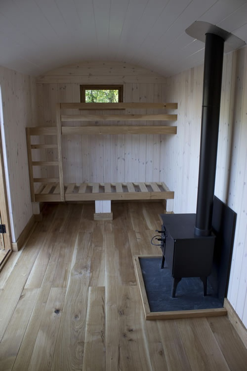 Bunkbed with window. Maybe turn bed sideways and have bathroom next to it.