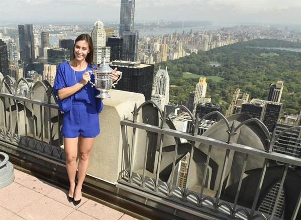 9/13/15 Via Tennis Photos: All smiles: US Open Champion Flavia Pennetta poses with the @USOpen trophy at the top of Rockefeller Plaza in New York. Flavia announced on-court that she plans to retire from tennis this year.