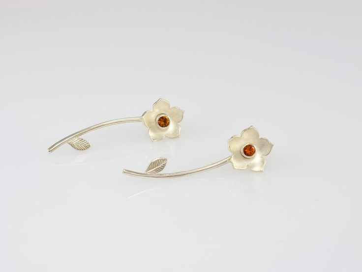 -Flower Gem Studs- NZ$155- Silver. A gorgeous and versatile flower set, that can be worn in 3 different ways! Enjoy a simple gem-set stud on its own, with the stud and flower head, or the whole set together with the stalk added behind the ear (in front of the scrolls) and it looks just like you poked a little flower stalk through your ear! Flower size 12mm, earring length with stalk 40mm, studs, gem size 3mm, available with various gems. Jewellery made @jewelbeetle in Nelson, New Zealand.
