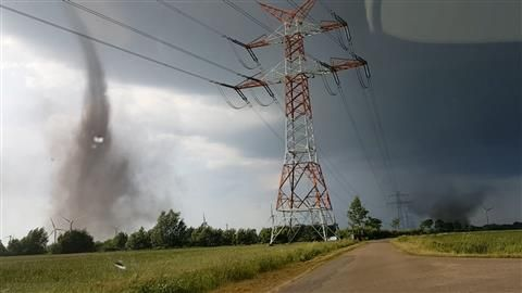 Cameras captured the moment twin tornados tear though a field of wind turbines in Schleswig-Holstein, Germany on Sunday.