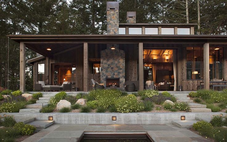 A farmhouse style, woodsy cabin was designed by Wade Design Architects along with Jennifer Robin Interiors, located in St. Helena, California.