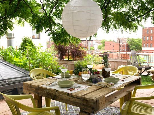 25 more DIY Pallet Ideas including: Coffee tables, outdoor dining table (pictured), sofas, daybeds, toddler beds, shelves, potting benches, wine bar, picnic table, head board, coat rack and more!