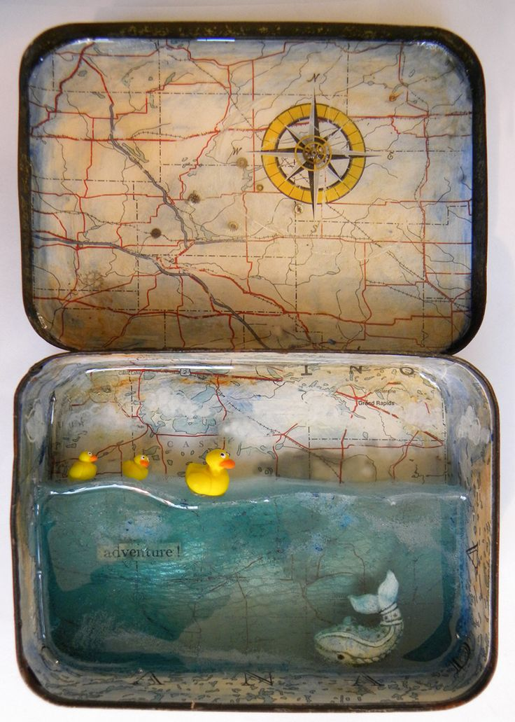 """Intrepid by hogret • Shadow box / diorama in a vintage toffee tin 3.5 x 5"""" (1 """" deep). • Paper, acrylic glazes, vintage watch parts, shower sponge netting, tinted resin. • Moby Dick is a small pottery bead; polymer ducks commissioned from *Athalour"""