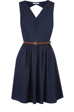 This denim wrap skater dress has a cut out detail to the back and comes with a belt attached. Finishing mid thigh and zipping up the side, this piece has a full skirt.