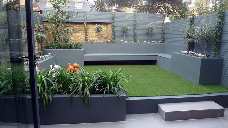 Raised beds grey colour scheme agapanthus olives artificial grass porcelain grey tiles grey Floating bench lighting designer courtyard Balham Clapham Wandsworth Battersea Fulham Chelsea London