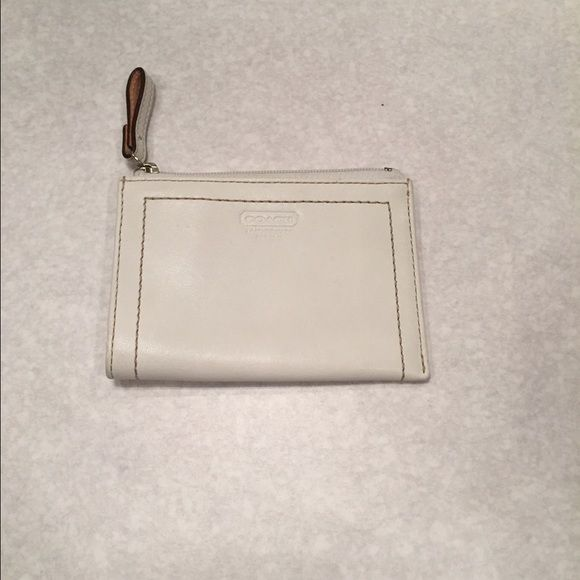 FREE with matching purse Skinny Wallet Good condition whit shimmer off white leather skinny mini wallet. Has wear signs as indicated in the last picture. Just surface wear with perfect interior. Coach Bags Wallets