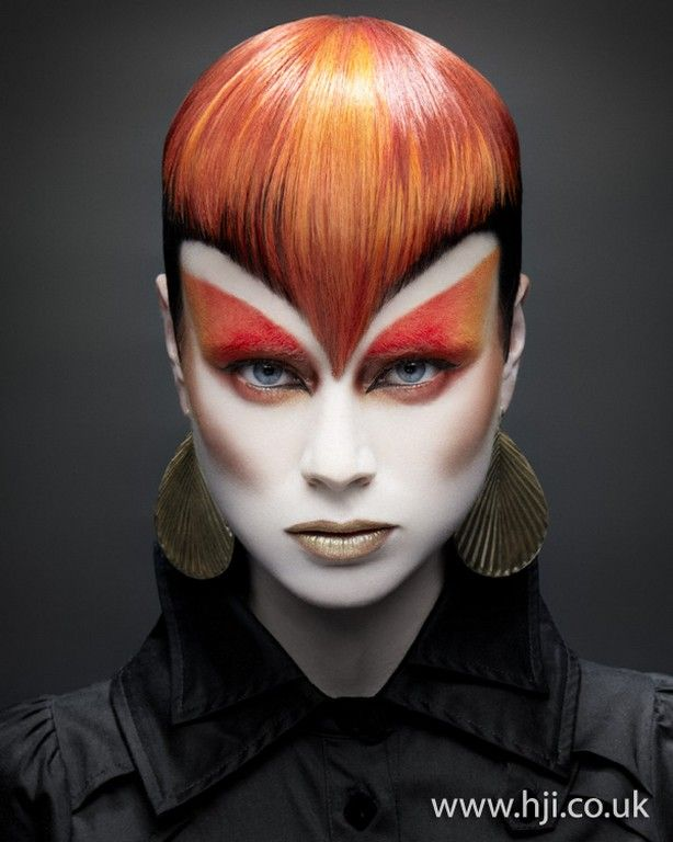 Red Sasson Cut Widows Point hair and Orange Winged Eyes.