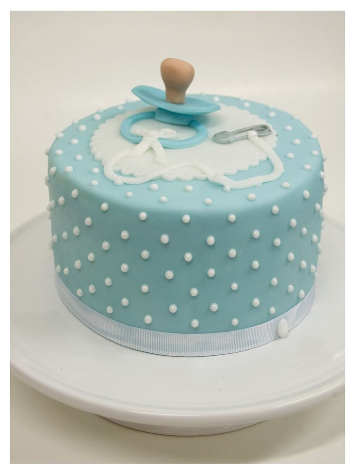 Blue fondant with raised dots topped with a pacifier ...A beautiful cake for a Baby Shower...... florentine cakes.files.wordpress