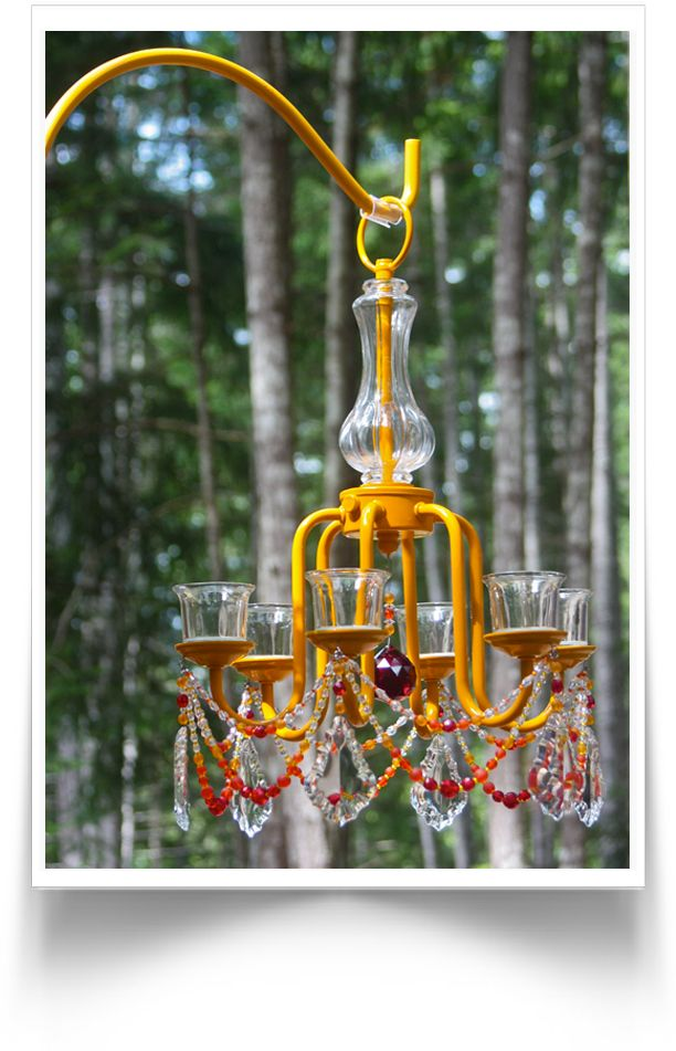 I like the idea of painting an old chandelier and putting it on the patio with solar lights!!
