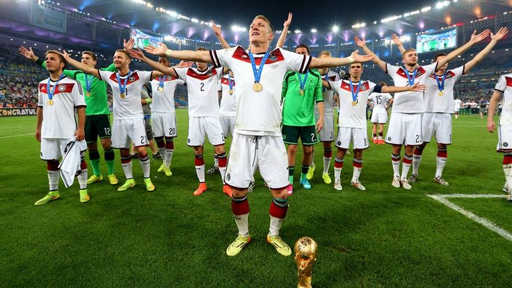 Fifa World Cup 2014 Brazil: GERMAN Celebration: German team saluting crowd in stadium with medals (Getty Images) • Germany wins 4th cup (1954+74+90+14)!! Equal to Italy. Only needing to beat one more, Brazil's 5. Germany's Mario Götze made only but beautiful goal in match against Argentina at 113th min in 2nd 1/2 of extra time, avoiding penalties!