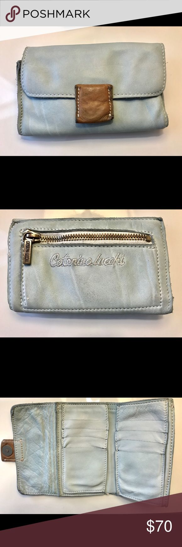 NWOT Caterina Lucci Anthropologie Calfskin Wallet NWOT Caterina Lucci Calfskin Wallet $150 retail. Made in Italy. Beautiful pale blue with camel colored leather patch snap closure. Embroidered logo on back. Distressed, ultra soft natural calfskin.   * Composition: Calfskin * Details: leather, solid color, logo, snap button closure, leather lining, internal card slots, billfold.  * Measurements: Height 3.9 inches , Width 5.85 inches made in Italy Anthropologie Bags Wallets