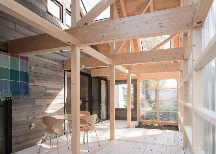 Timber-framed home by Yoshichika Takagi has attic bedroom and translucent sunroom