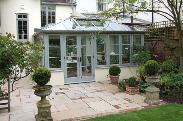 A Wooden conservatory in Mist with statement French doors with Black handles